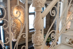Ornate iron newel post located on the first floor landing of the Grain Belt brew house
