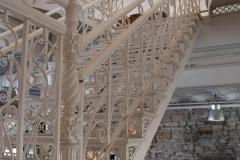 Original iron work stairway running up from the first floor in the Grain Belt brew house