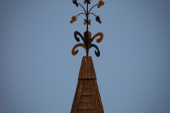 Weather vane on top of the clock tower of Old Main Hall at Hamline University