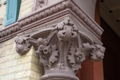 Corinthian capital topping the left column at the entrance to Old Main Hall