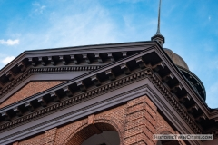 Ornate corbels and dentils adorning the cornice of the Historic Washington County Courthouse - Stillwater, MN
