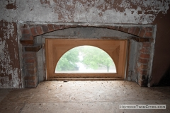 Top arch of what was a second floor window that is now located in the unfinished third floor of the old Dakota County Courthouse due to a renovation