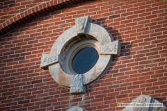 Round window on the front facade of the old Dakota County Courthouse