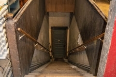 Stairway leading from the attic down to the third floor of Pillsbury Hall - University of Minnesota