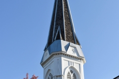 Belfry and spire atop the steeple of the Historic Church of St. Peter in Mendota