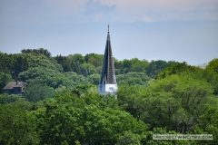 View of the steeple of the Historic Church of St. Peter from the south on the Mendota Bridge spanning the Minnesota River