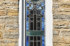 Stained glass window on the Historic Church of St. Peter in Mendota