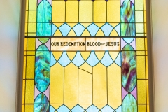 Stained glass window as viewed from inside the Historic Church of St. Peter in Mendota