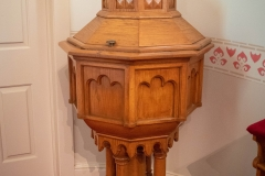 Baptismal font in the sanctuary of the Historic Church of St. Peter in Mendota