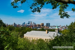 View from the base of the Witch's Hat Water Tower with Pratt Elementary School in the foreground and downtown Minneapolis in the distance