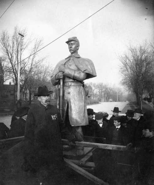 Josias R King standing in front of the Soldiers and Sailoers Memorial circa 1903 (MHS)
